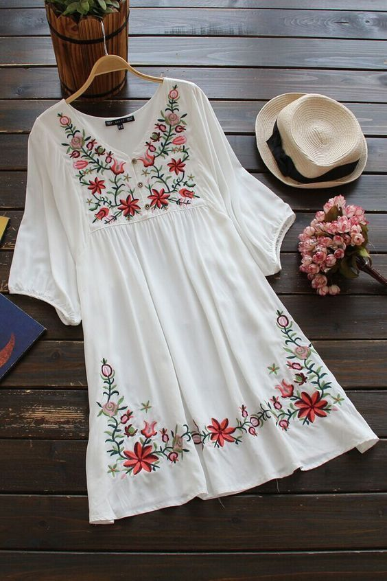 Embroidered Flora Vintage Style Peasant Dress features a colorful floral embroidery along the neck and hem. It has a comfy Vline Neckline with breezy loose sleeves. This style looks good with both san