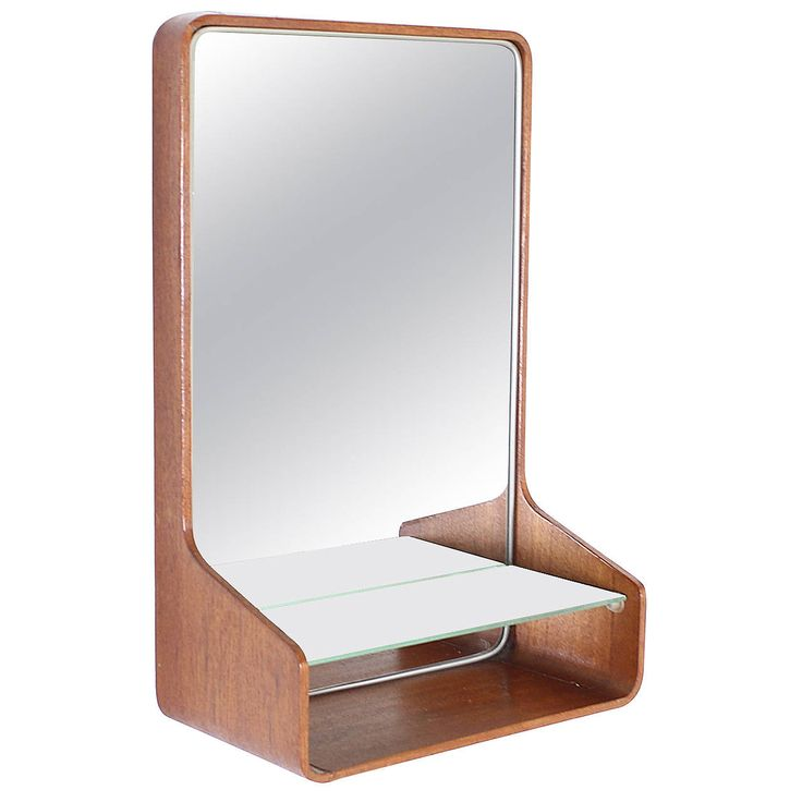 Friso Kramer Small Teak Plywood Wall Mirror for Auping, Holland | From a unique collection of antique and modern wall mirrors at https://www.1stdibs.com/furniture/mirrors/wall-mirrors/