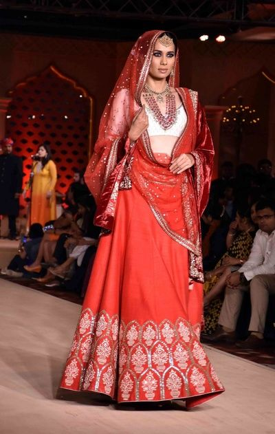 white and red , white blouse , red lehenga , gold work , red sheer dupatta , deep scoop neck blouse, sleeveless blouse , light lehenga , bridal lehenga
