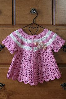 Every little girls needs a crochet sweater! All of these are just too precious not to share! How cute is this Cozy Hooded Jacket? I love all the different color buttons and the cute little pom pom on top!   This Mini Moogly Sweater is to die for! who doesn't love shell stitch-like …