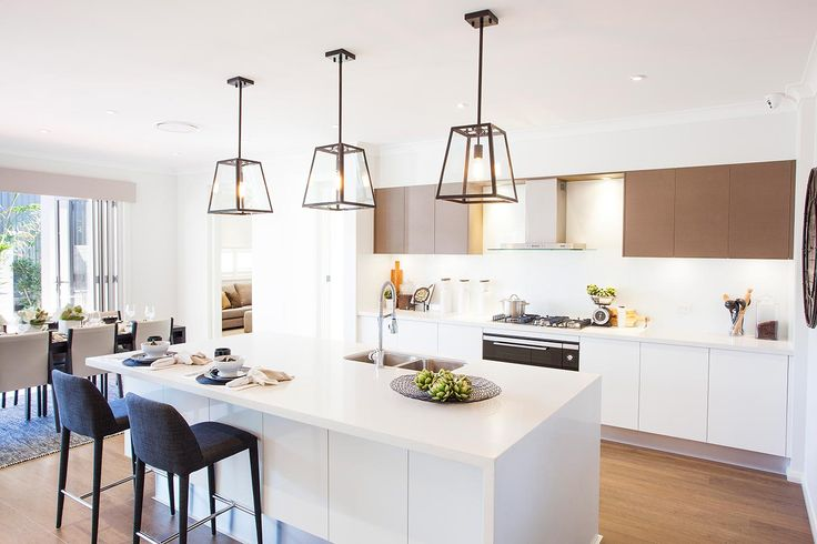 These stunning pendant lights add an industrial twist to this gorgeous kitchen in our new Seaside Retreat display home at Willowdale. #kitchen #pendantlights #industrialkitchen #displayhome #mcdonaldjones #newhome #homebuilder