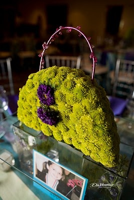 Floral purse center piece so fun by Isha Foss