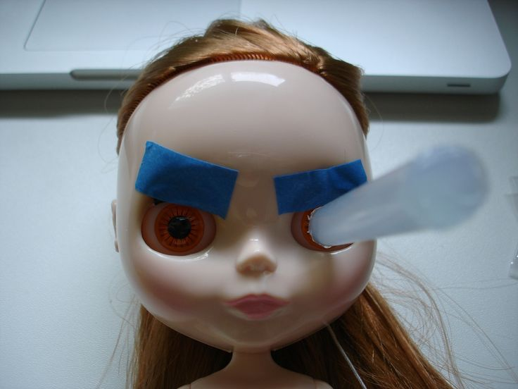 1. To avoid getting glue on the lashes, tape them to the top of the eye socket. Use low-stick painter's tape.   2. Melt the glue stick with a lighter or on the metal tip of a glue gun. Turn it upside down for two seconds, then stick it into the doll's eye.  3. Apply pressure to the glue stick for 90 seconds.   4. Let the glue stick sit for 5 minutes.   5. Twist and pull the glue stick, and the eye chip should come right out.   Edit: Removing the side-facing eye chips can also be done ...