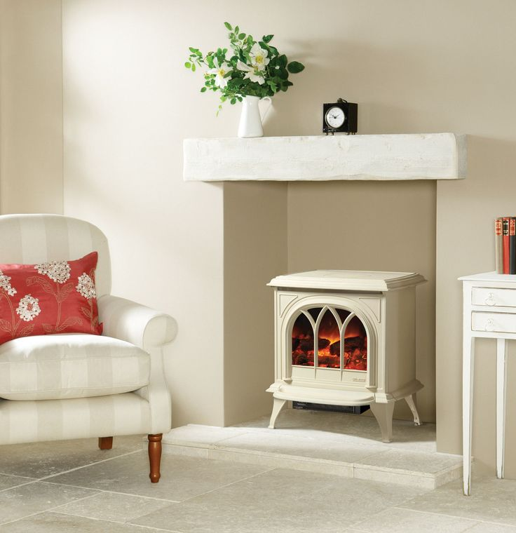 Gazco Huntingdon Electric Stove. The enchanting look of a traditional stove, available in a range of sumptuous colours, combined with the absolute convenience of an electric appliance and thermostatic remote control. #gazco #electric #stove