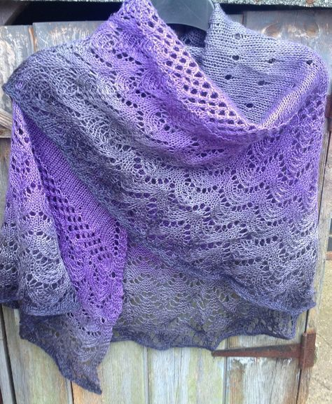 Free Knitting Pattern for One Skein Kindness Shawl - 3 sections of different lace patterns showcase ombre or multi-color yarn. Uses one skein of fingering yarn containing 415 – 430 yards (379 – 393 m). Designed by Jaala Spiro for KnitCircus. Pictured project by Knitaway1111