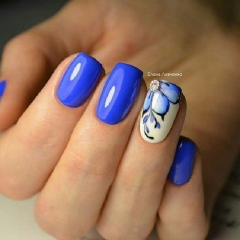 Glossy Blue with White Nail Art. Get your nails painted with this simple and classy nail art design with blue color.