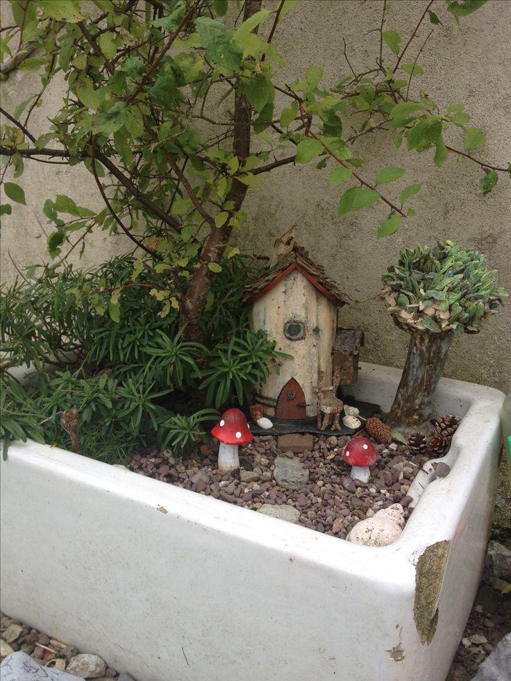 Our fairy garden in an old Belfast sink