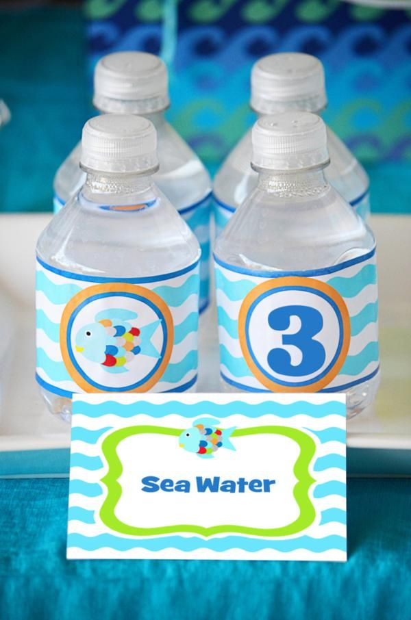"""Sea water"" labels and ""Fish food"" favors; Love the welcome sign, ""It's good to SEA you!"""