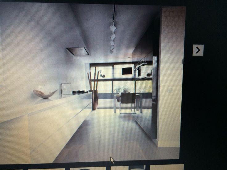 Mooie oplossing voor keuken in  smalle doorgang in u-vormige ruimte
