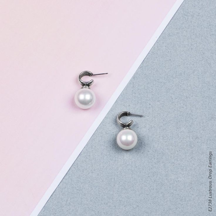 E2738 - Lustrous white shell pearl drop earrings with burnished silver caps