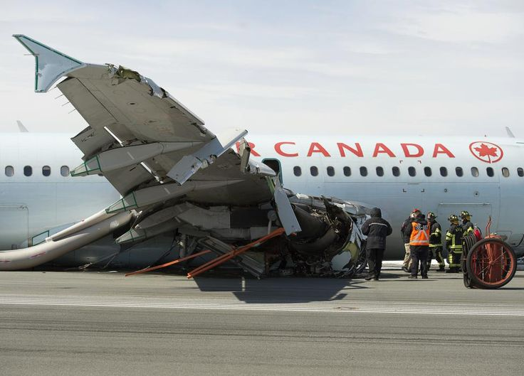 Transportation Safety Board investigators and airport firefighters work at the crash site of Air Canada flight 624 that crashed early Sunday morning during a snowstorm, at Halifax Stanfield International Airport in Enfield, Nova Scotia, March 30, 2015. The Air Canada plane landed short of the runway and hit an antenna array, losing its landing gear, safety officials said. REUTERS/Andrew Vaughan/Pool