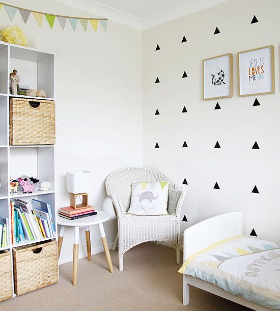 Triangles are a popular motif in Scandinavian design, so pepper them throughout your space for three-sided style. Here, black triangles infuse a children's room with whimsical flair. By continuing the motif in the framed artwork and bunting banner, the repetition feels both intentional and mod./