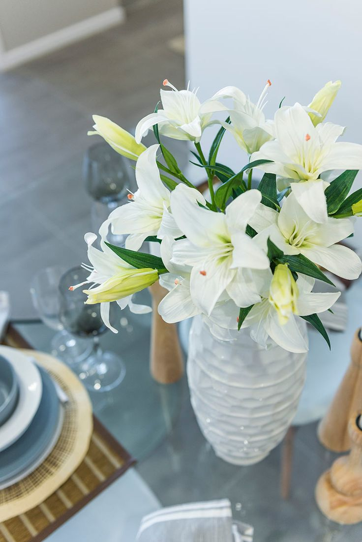 This #table #setting is from Ausbuild's  Denham display home, flowers can add a touch of elegance to any #dining table.  www.ausbuild.com.au.