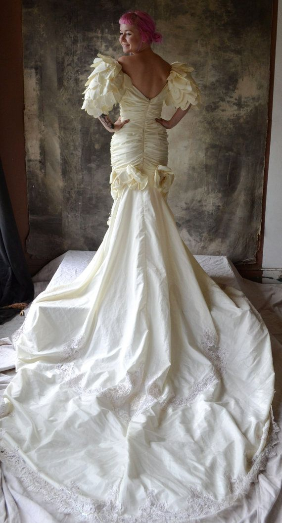 This amazing 1980s wedding dress has a ruched body embellished with a sequined…