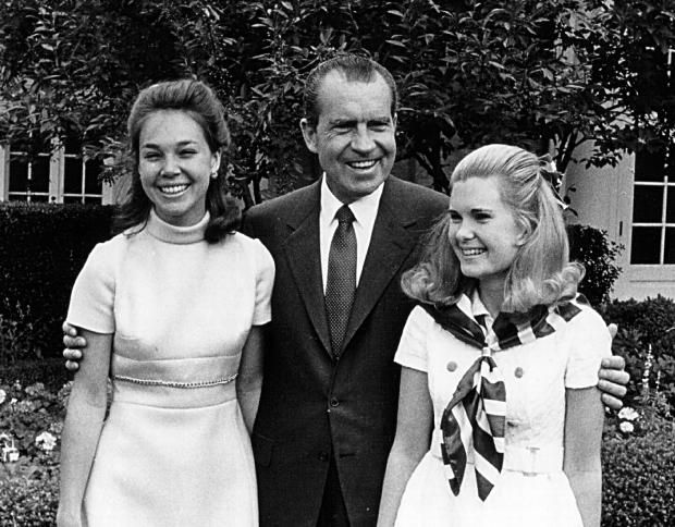 Tricia Nixon Cox and Julie Nixon Eisenhower with President Nixon.  What a shame to do something so stupid and ruin your legacy.