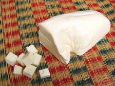Wiki: Indian Paneer Cheese, Chhana, Chhena, Cottage Cheese: Fresh, unaged, acid-set, non-melting farmer or curd cheese. Common in South Asia, especially in Indian, Pakistani, Afghan, Nepali, Bangladeshi cuisines. Made by curdling heated milk w/lemon juice, vinegar, or any other food acids. Chhena: crumbly & moist form in E India & Bangladesh. Similar: Queso Blanco, Queso Fresco, firm Quark, dry curd cottage cheese (Paneer is not salted.) - Wikipedia