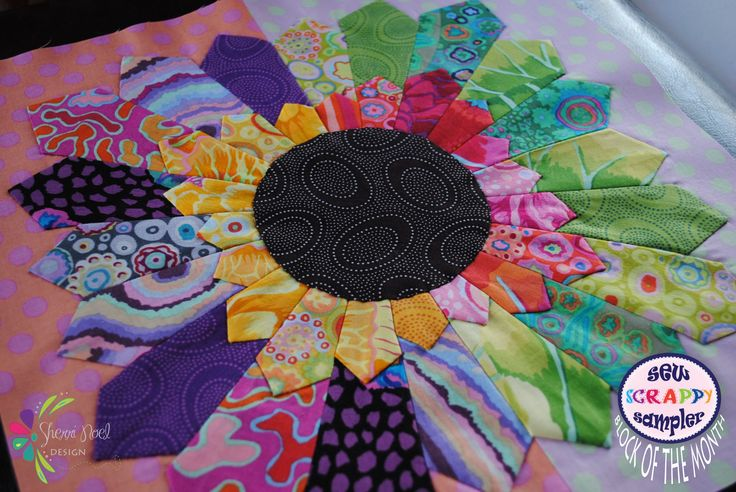 Quilt Block of the Month ~ Sew Scrappy Sampler Quilt Pattern 2015 uses wedges circles and applique techniques.