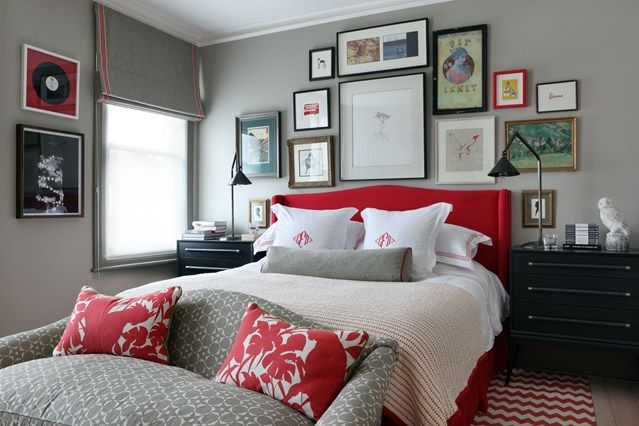 Red headboard from The Holiday and picture wall above