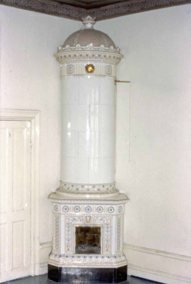 White columnar tiled stove in pastel colours, ca 1890. Height 300 cm.