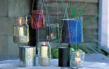 Tin-can & Glass-jar Lights  Set your backyard, porch or terrace aglow with theses fun lights.