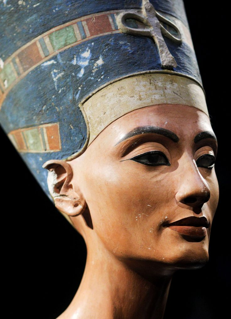 Nefertiti Bust, a 3300-year-old painted limestone bust of the Great Royal Wife of the Egyptian Pharaoh Akhenaten, believed to have been crafted in 1345 BC by the sculptor Thutmose.