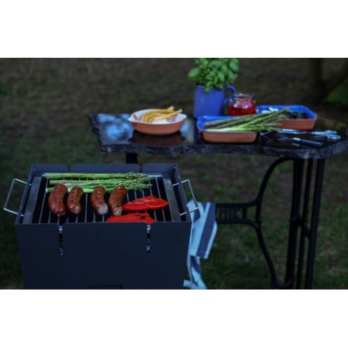 """Buk"" Grill - Metal charcoal grill with a cooking grate."