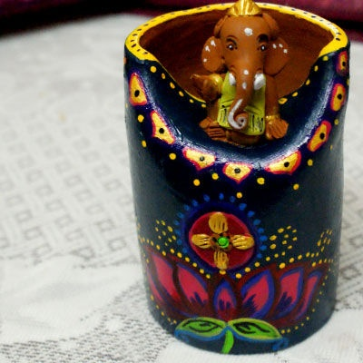 Beautiful terracotta ganesha stationary holder in beautiful vibrant colors.