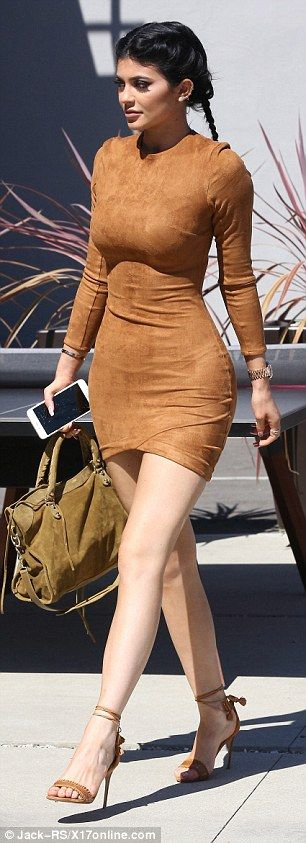 Kylie Jenner wears blue contacts and tight suede mini-dress #dailymail