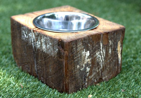 Solid wood block dog bowl stand. Handcrafted out of a single block of reclaimed wood that is approximately 70-100 years old and salvaged from a demolished home in Atlanta, GA. Comes with 8 stainless steel bowl.
