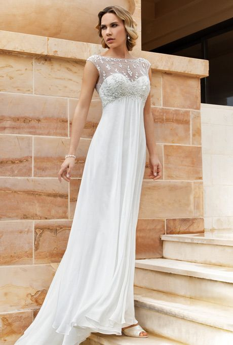 Brides: Demetrios - Destination Romance . Chiffon gown with a sweetheart neckline and sleeveless sheer beaded overlay with a low V-back and buttons. Flowing A-line skirt features a chapel train.
