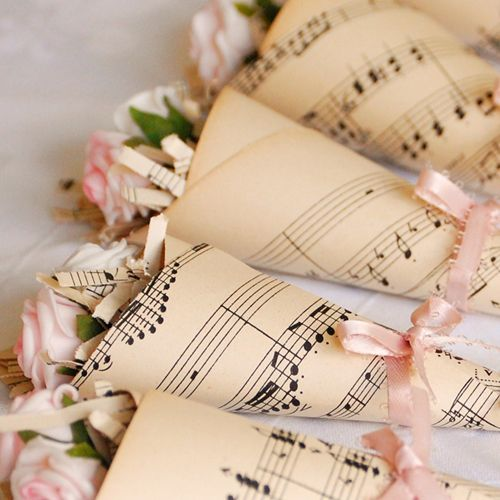 Vintage Music Sheet Rose Cones...beautiful favours for the ladies! Lay across their place settings or place in a bowl for a stunning table centrepiece.
