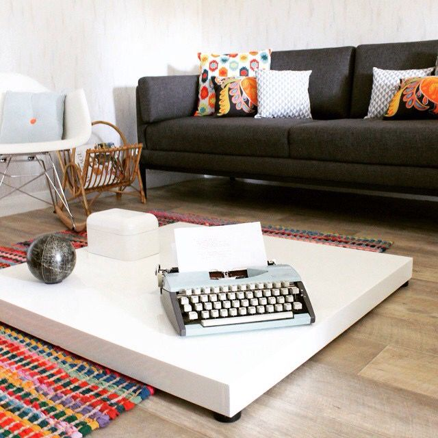 Vintage typewriter, small table, eames chair rar, vintage sofa & cushion