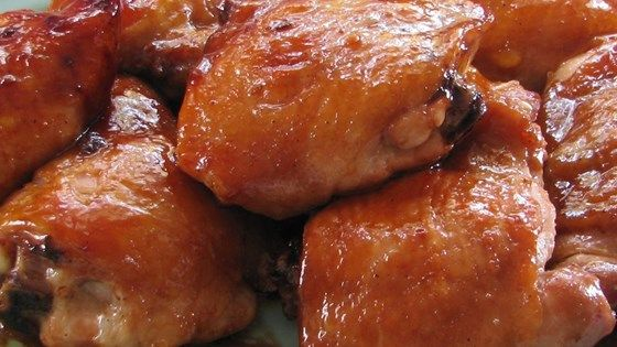 Chicken pieces are coated with a homemade teriyaki sauce and baked to perfection in the oven. Easy to double for a large group.