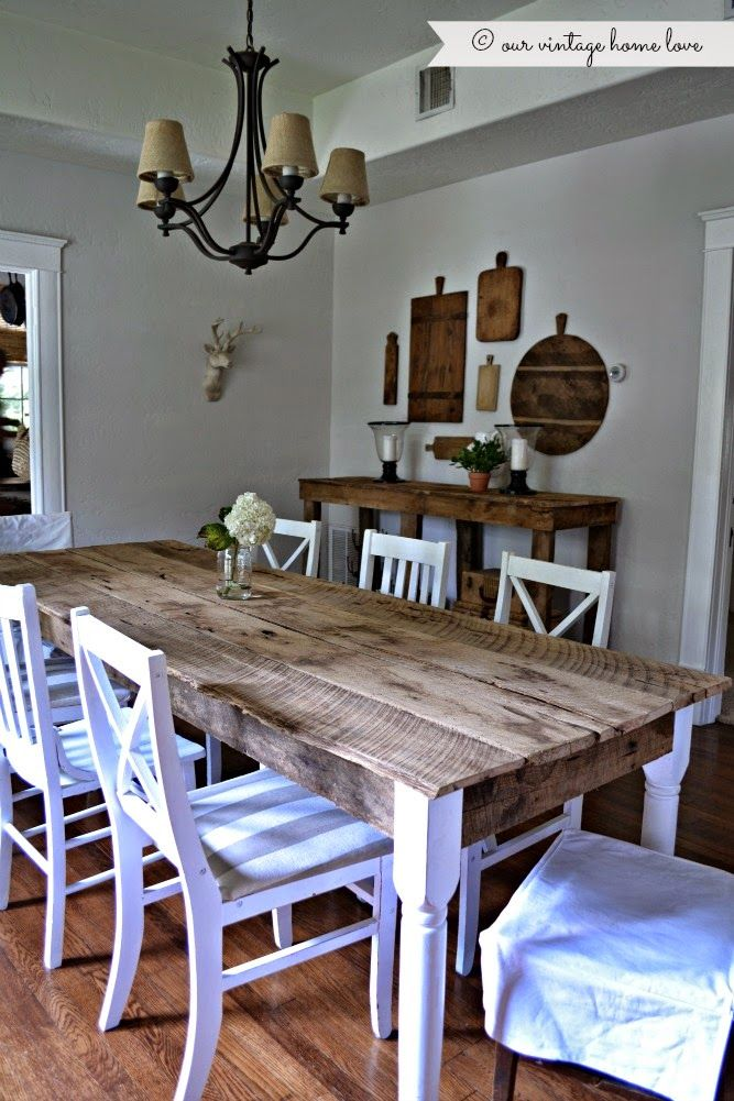 """cannot get enough of """"our vintage home"""" blog. Loving the vintage bread boards above the server. Have a few myself...great idea."""