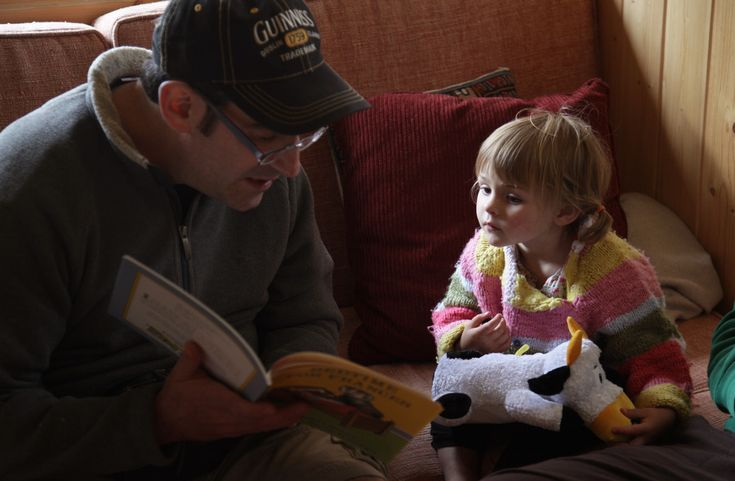 Chris So captured this typical Randy Starkman moment, reading from a children's book (Bedtime for Frances) which be gave to Aria Renner, then two years old.