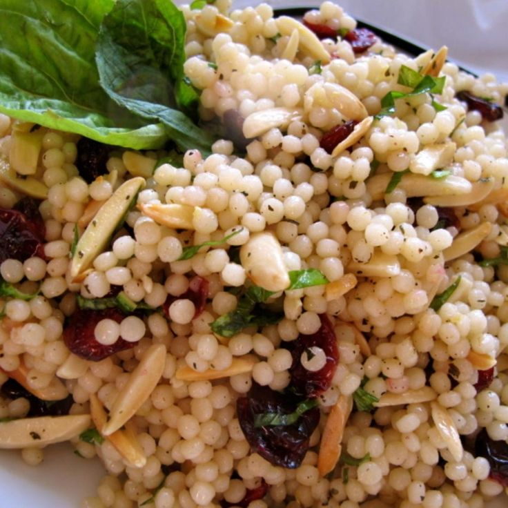 I found this recipe from Giada De Laurentis but adapted it to my taste.. It is really yummy!!! I love salads like this, i've never had israeli couscous before but it's delicious! It is basically pasta so if you can't find it (I found mine at Trader Joe's) just use a small pasta and it won't be a big deal.. Hope you like it!
