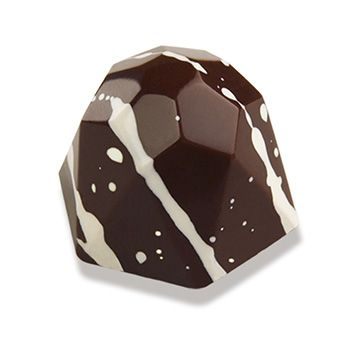 Christopher Elbow Chocolates.  This Fleur De Sel Caramel is but a single taste of the unparalleled decadence that Christopher Elbow artfully crafts.