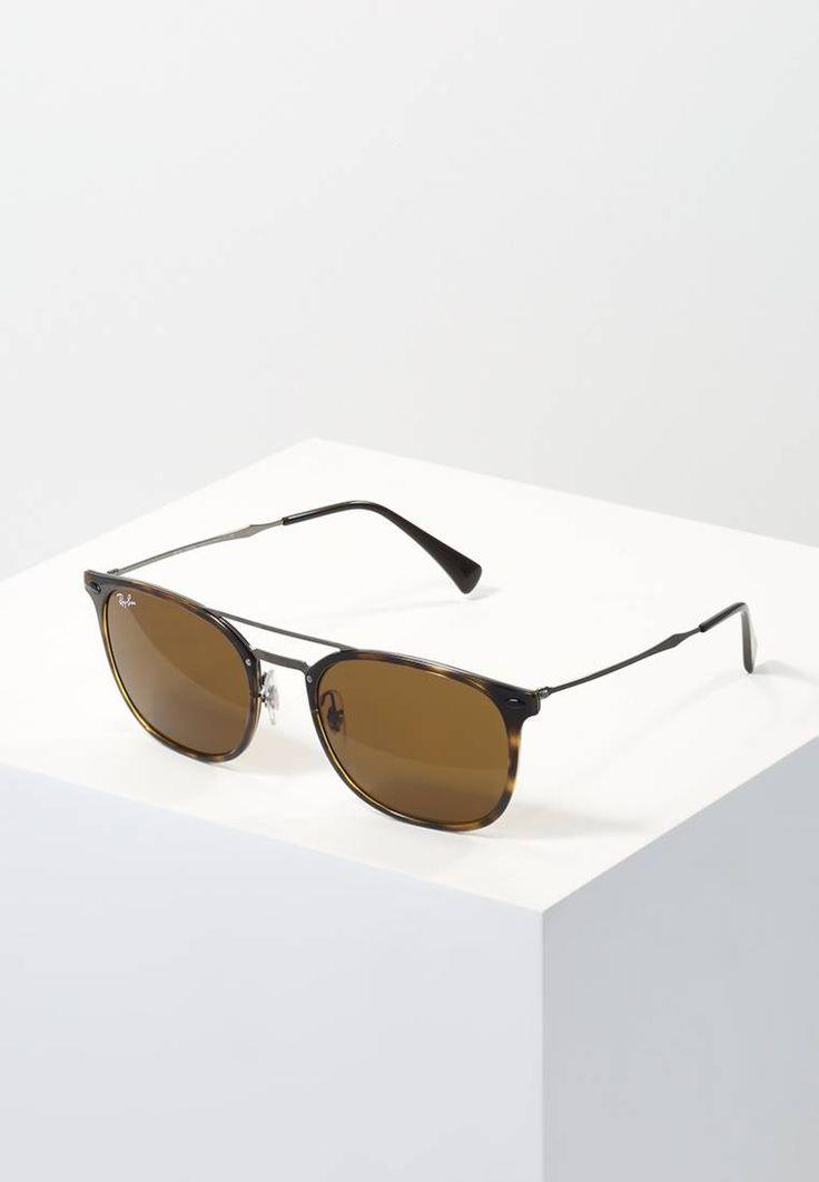 Ray-Ban. Sonnenbrille - dark brown. Breite:14 cm bei Größe 55. Bügellänge:13.5 cm bei Größe 55. Stegbreite:1.6 cm bei Größe 55. UV-Schutz:ja. Brillenform:Wayfarer (Trapez). Brillenetui:Hartschale