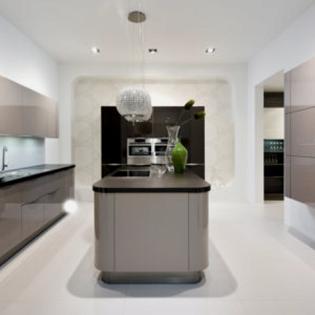 Fabulous Lack gloss designer kitchen in a modern u uncluttered slab style
