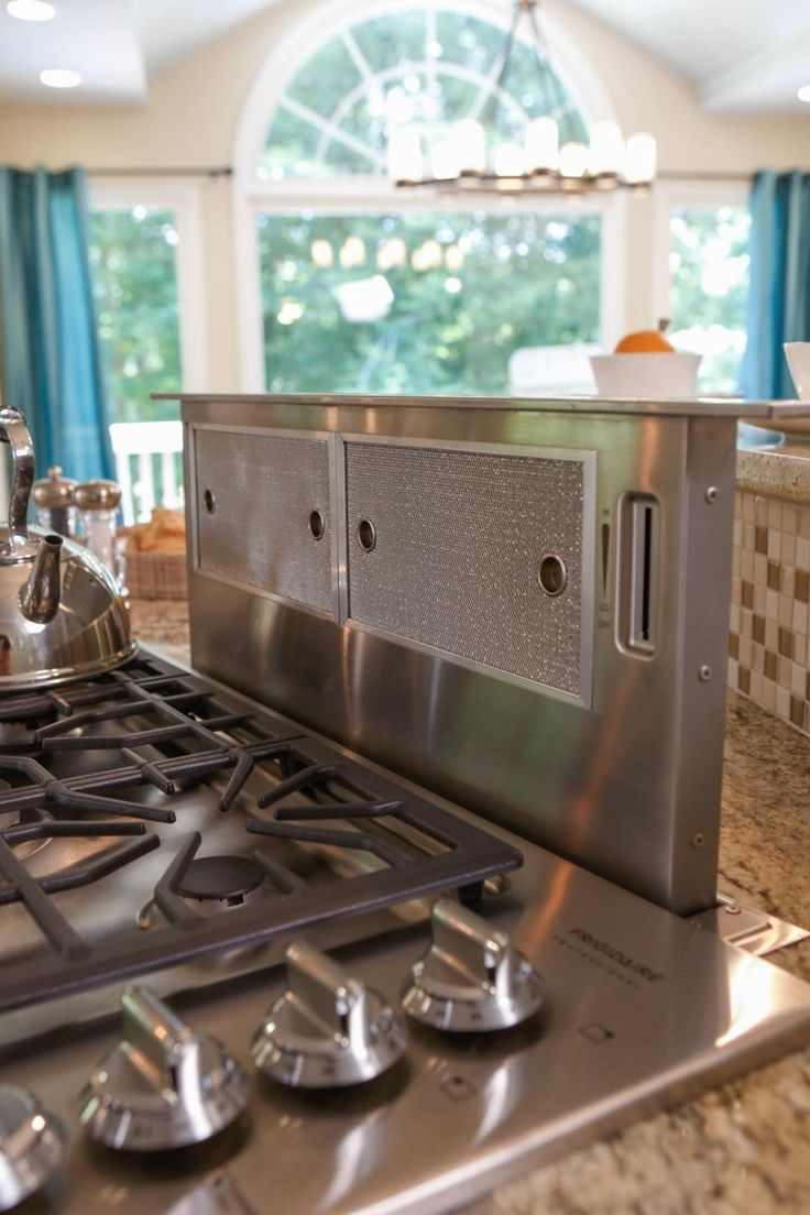 29 best kitchen images on pinterest kitchen home and kitchen ideas kitchen after the range vent rises out of the counter top eliminating the