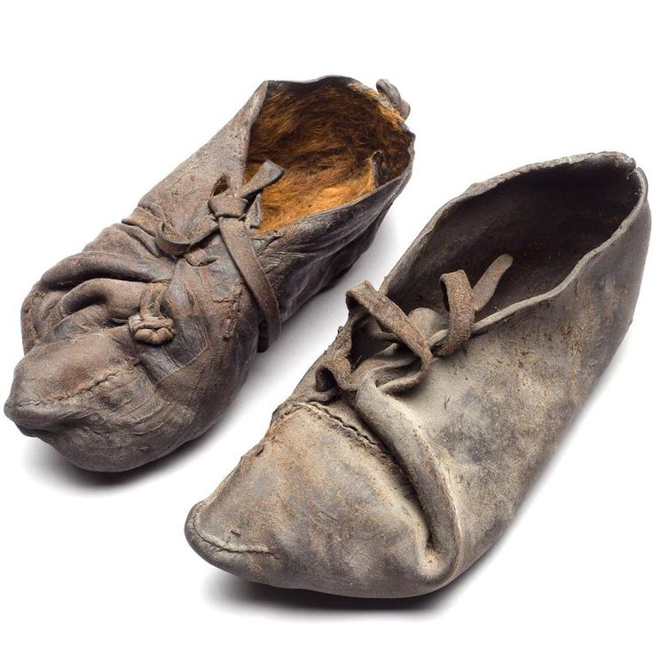 A pair of cowhide shoes. Found with a Danish bog body they date from c. 355-47 BC