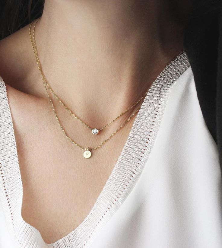 Our best sellers: the Solitaire Necklace and the Charm Necklace. Made from 14k solid gold so they can be worn every day and never fade, and always without the retail markups. | Vrai & Oro