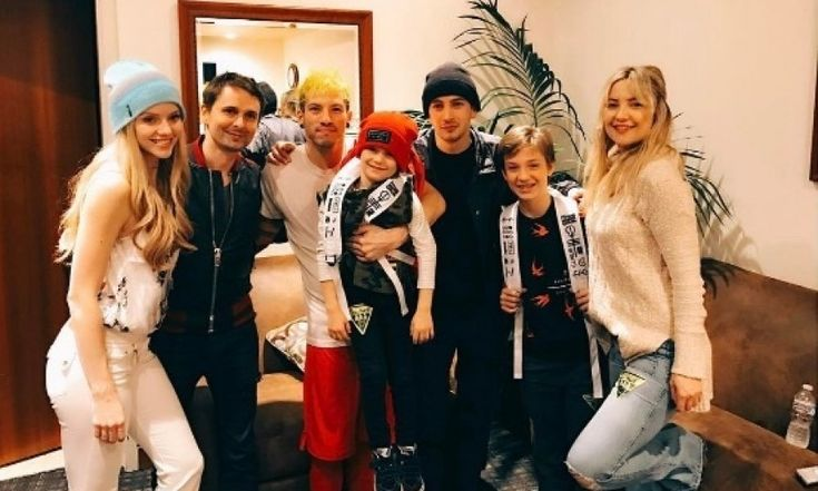 """Kate Hudson and her ex Matt Bellamy surprised their son Bingham and his brother Ryder with the show of a lifetime. The actress posted a photo of her, the boys and Matt smiling around the band, Twenty One Pilots.   """"Surprised the boys tonight with their favorite band @twentyonepilots. Thank you guys and the whole TOP family for making it so special. We had a blast."""""""