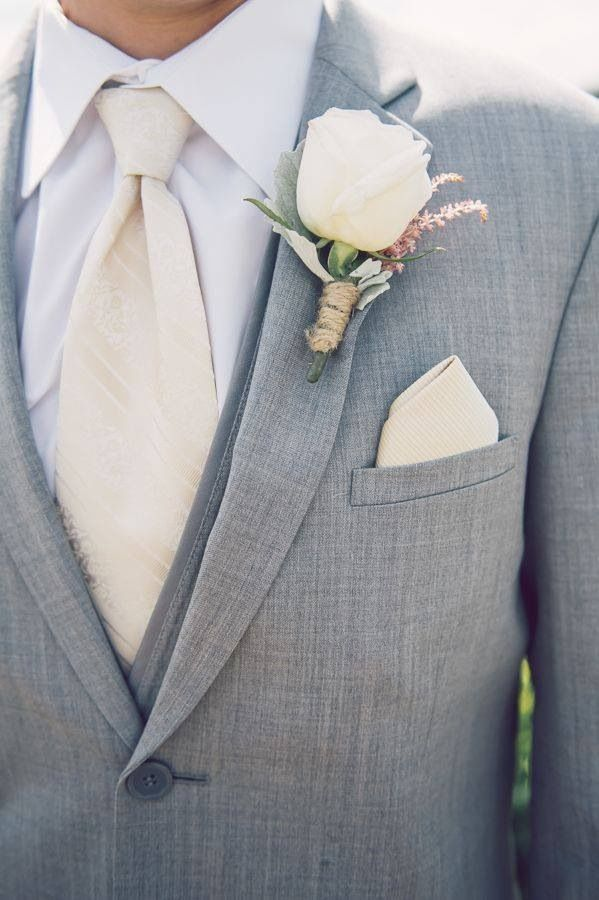 Ivory is a great colour for a groom to wear if it will match the brides dress. Seen here it compliments a light grey suit well.:
