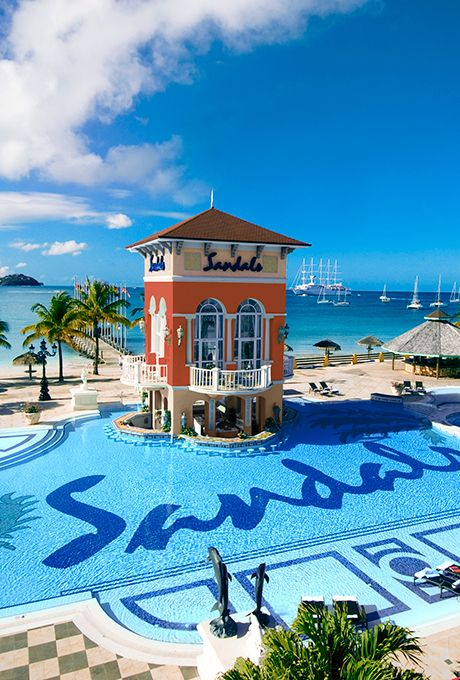 Brides.com: . 6. Sandals Grande St. Lucian Spa and Beach Resort in St. Lucia    Honeymooners rave about this couples-only all-inclusive Gros Islet, just west of Rodney Bay, where not only will you be able to sip daiquiris and dig into breakfast, lunch, and dinner without ever hauling out your wallet, you can play golf and dive as much as you want, gratis; Sandals Grande St. Lucian