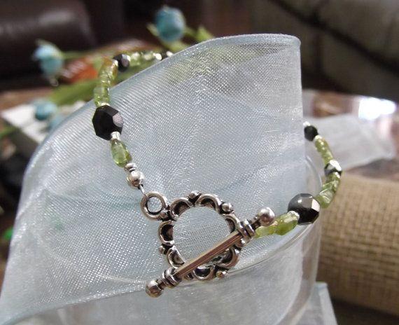 Green Peridot and black crystal bracelet by LifeStoneJewelry.