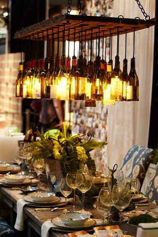 wine bottle chandelier... Better with clear bottles, circular shape and different levels..