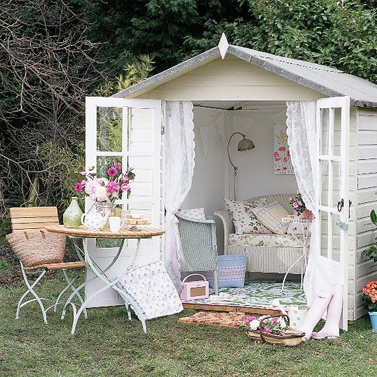 "I would love to spend the day out in this summer shed made by ""Focus"".  This is so sweet and soothing - oh, what a beautiful place!  The lace curtains are from Ikea, the rug from Habitat, and the sofa and armchair are Lloyd Loom of Spalding.  Found at www.housetohome.co.uk./garden.  What a perfect spot for a tea party with a good friend or two!"
