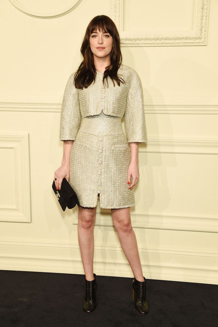 The Fifty Shades of Grey star was elegant, yet cool in a roomy tweed skirt suit and lace-up booties.   - MarieClaire.com