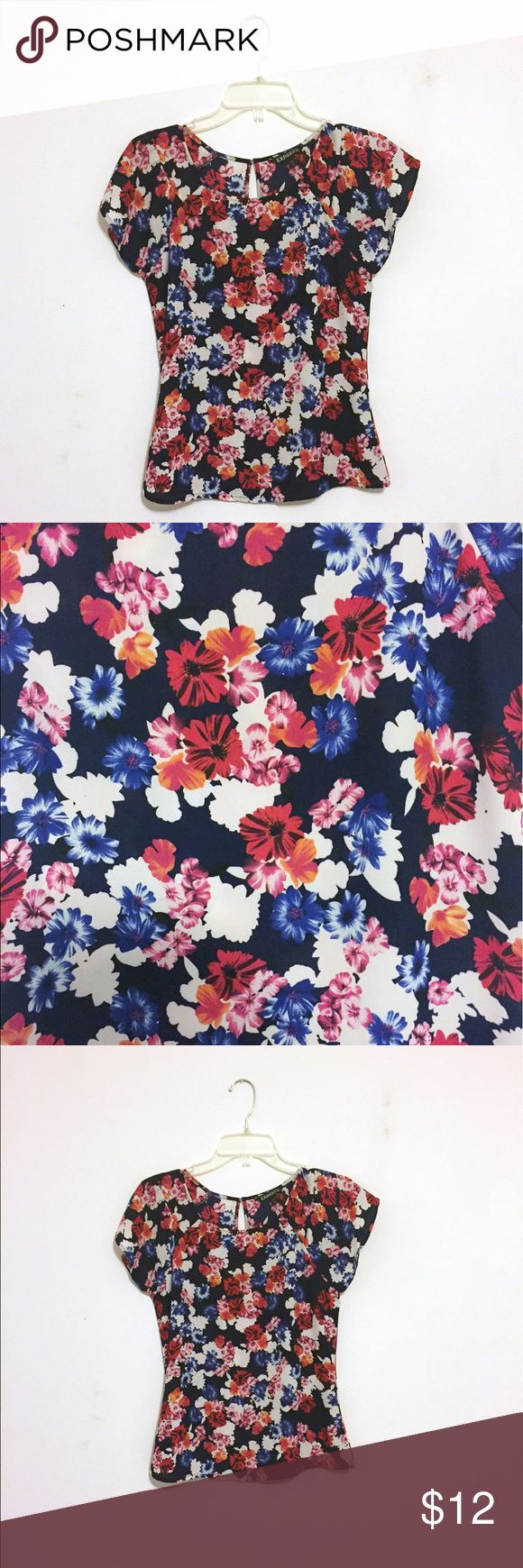 Express Flower blouse Adorable flower print blouse originally from Express. Perfect with skirts or jeans. Tops Blouses